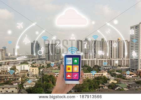 iotInternet of things(business concept)smart citycloud concept.Business man use application in mobile phone and augmented reality technology to control monitor and management the datainformation