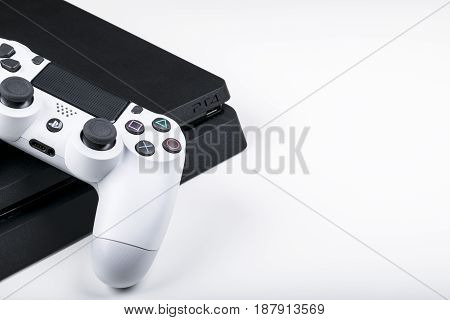 Sankt-Petersburg Russia May 20 2017: Sony PlayStation 4 game console with a joystick dualshock 4 home video game console developed by Sony Interactive Entertainment.