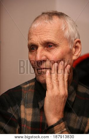 LUTSK UKRAINE - 16 DECEMBER 2008 - An unidentified elderly man posing at indoor.