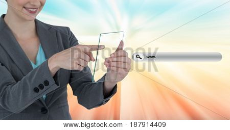 Digital composite of Midsection of businesswoman holding transparent device