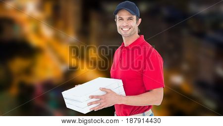 Digital composite of Happy delivery man holding pizza box