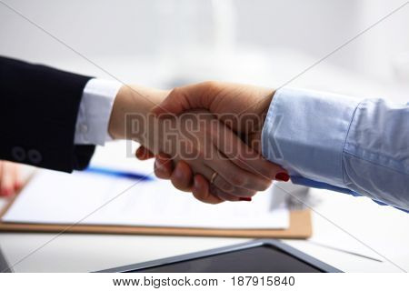 Business people shaking hands, finishing up a meeting, selective focus .