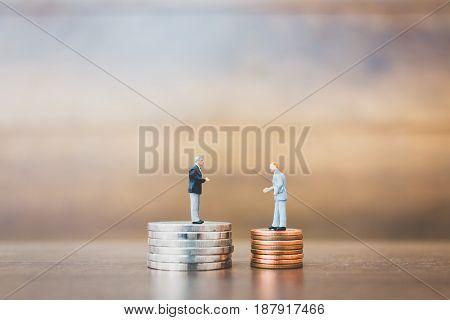 Miniature People Businessman Standing On Money