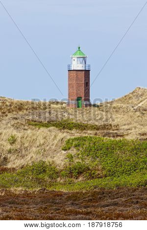 Small old lighthouse in the dunes of Kampen, North Sea island of Sylt, Germany