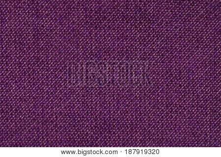 Dark purple background from woolen texture textile closeup. Structure of the wine wicker fabric macro.