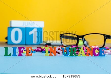Life insurance, family services, supporting concepts. Word composed of small colored letters on business workplace of insurance agent or doctor cabinet.