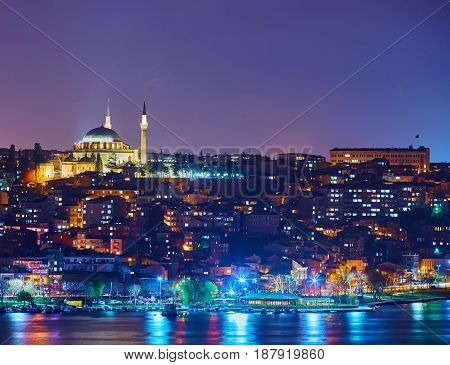 Fatih Mosque and bay Golden Horn at night