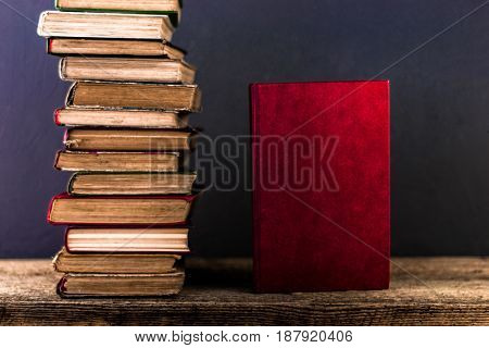 Books on an old wooden table open