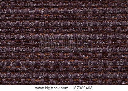 Dark brown background from checkered pattern textile closeup. Structure of the umber wicker fabric macro.