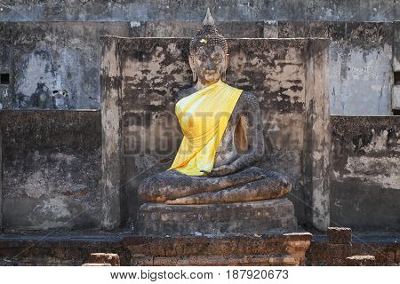 ruined ancient seat sitting buddha statue at Sukkothai, Thailand, buddha statue without hand and arm