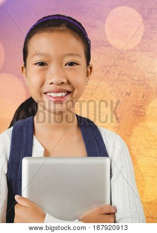 Digital composite of Girl with tablet against map with bokeh