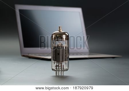 radio tube and a notebook on a gray background