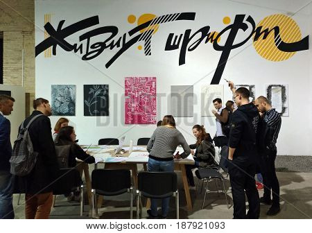 KIEV - UKRAINE - MAY 2017:  Art and book exhibition in Arsenal museum in Kiev. The stand of calligraphy at the book exhibition in Arsenal, in Kiev. People learn calligraphy.