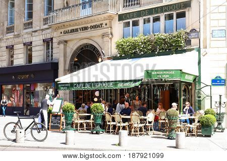 PARIS -May 16, 2017: View of vintage paris cafe de Belle epoque in quarter of commercial Bourse in Paris, France