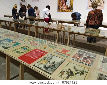 KIEV - UKRAINE - MAY 2017:  Art and book exhibition in Arsenal museum in Kiev. Visitors of the exhibition view the exposition of the satirical almanac