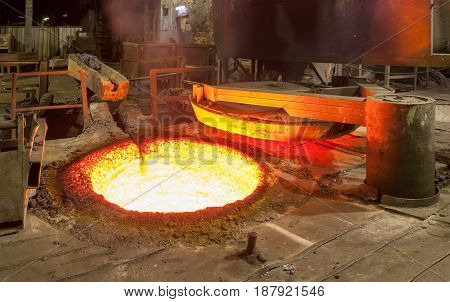 Open fuel furnace of mine type for remelting cast iron - blast cupola. Extended large furnace cover