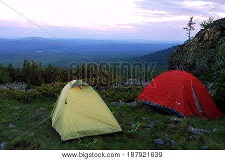 Travel To Ural Mountains, Russia. The Camping In Mountains With Tents.
