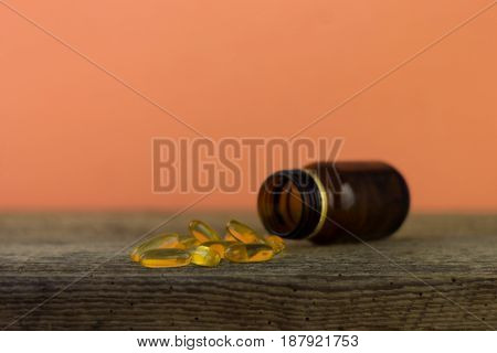 Glass bottle for pills. Old table. Beautiful  background.