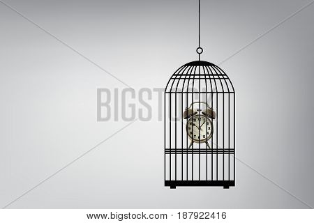 Time Management Concept : Retro alarm clock in bird cage with gray background. (3D Illustration)