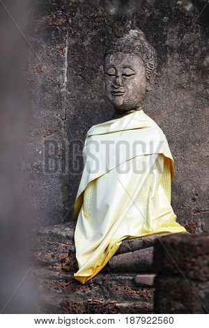 ruined ancient sitting buddha statue at Sukkothai, Thailand, buddha statue without hand and arm