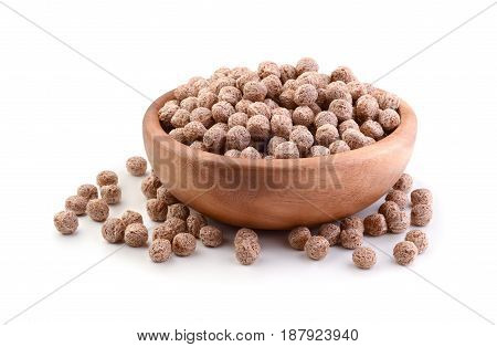 Bran in a wooden bowl isolated on white