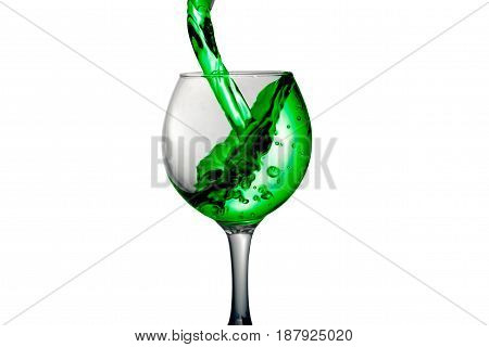 Green Water Pours Into A Glass On A White Background