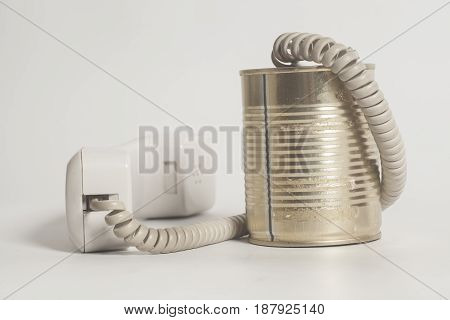 Tin can phone with handset on white background