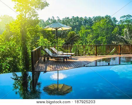 Bali, Indonesia - April 14, 2014: View of swimming pool at Nandini Bali Jungle Resort and Spa.