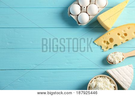 Dairy products on wooden table, top view
