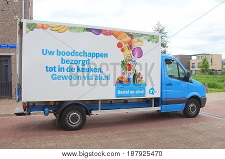 Almere, The Netherlands - May 24, 2017: Albert Heijn delivery truck parked on a public road in the city of Almere. Nobody in de vehicle.