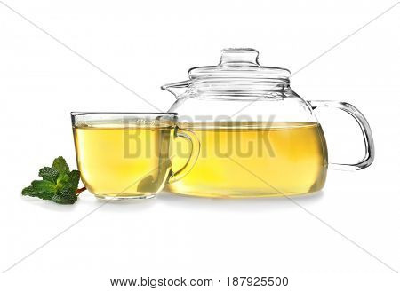 Teapot and cup of tea on white background