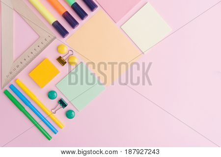 Picture of office supplies on the pink background table