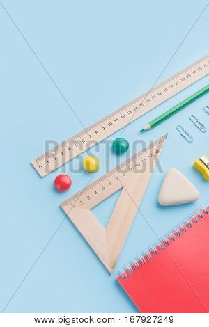 Picture of office supplies on the blue background table
