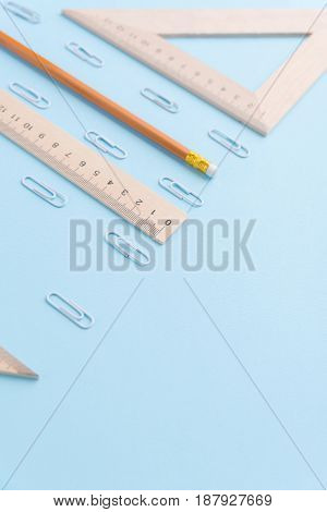 Photo of office supplies on the blue background table