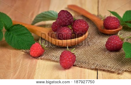 Raspberries in a rustic setting. Health from nature. Proper nutrition. Close-up. The selected focus.