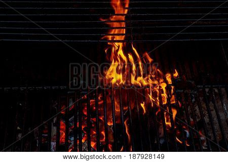 Hot Empty Charcoal Bbq Grill With Bright Flames On The Black Background.