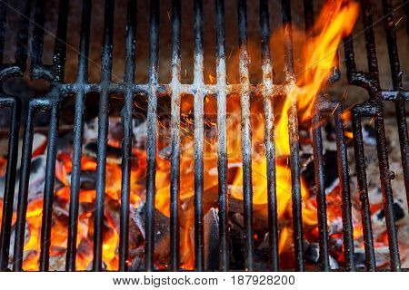 Top View Of Empty And Clean Barbecue Charcoal Grill With Flames