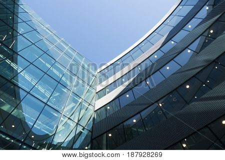 A part of modern business building against blue sky as background