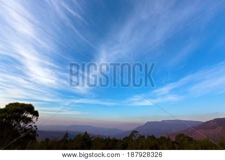 Beautiful gradient of blue purply sky of mountains range, view from Liffey Forest Lookout platform on Highland Lakes Road in evening view. Autumn in Tasmania, Australia