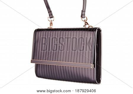 Woman's evening fashionable stitched brown clutch with golden details made of smooth shining patent leather isolated on white background. Logos removed.