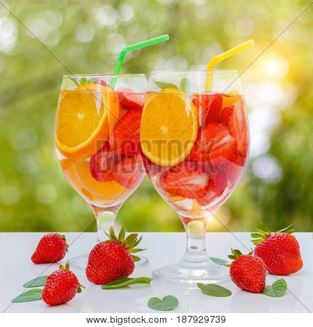 Flavored Water With Fresh Strawberries And Mint In Glass Glasses .