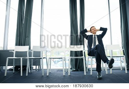 Young man waiting for job interview indoors