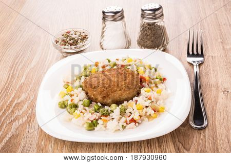 Fried Cutlet With Vegetable Mix In White Plate, Spices