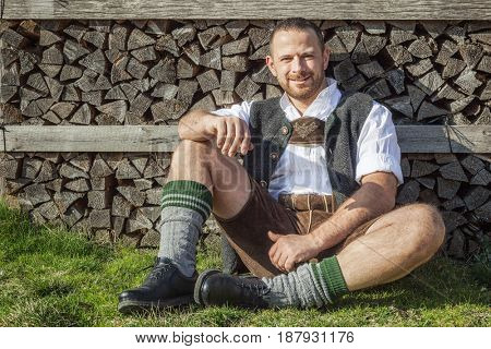 An image of a traditional bavarian man is taking a rest