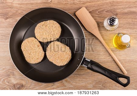 Semi-finished Cutlets In Frying Pan, Spatula, Salt And Oil