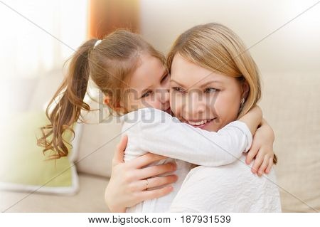 Mother And Her Little Daughter Child Girl Playing And Hugging.
