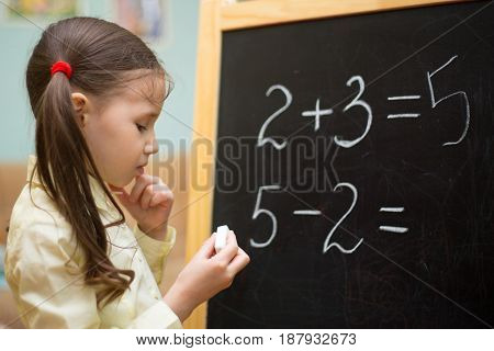 Beautiful Young Girl Is Teaching At Home On Blackboard. Preschool Home Education.