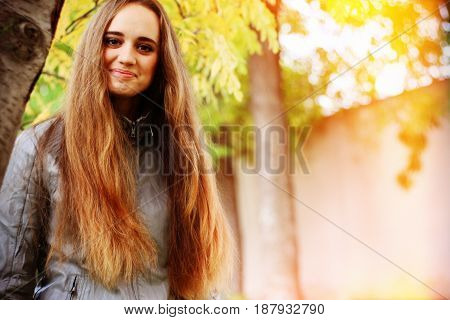 young woman portrait in autumn color. Outdoor