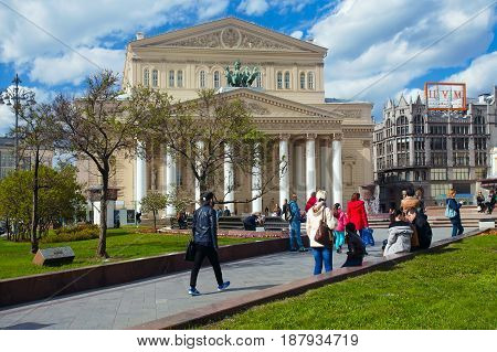 Moscow Russia - May 13 2017: The people walking at the building of the Bolshoi Theatre on Theatre Square in the center of Moscow