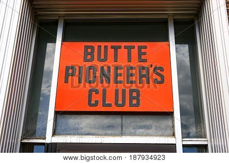 Butte, Montana, USA - 07/21/2015: The Butte Pioneer's Club sign above the doorway of this community group building on S. Montana Street in Butte